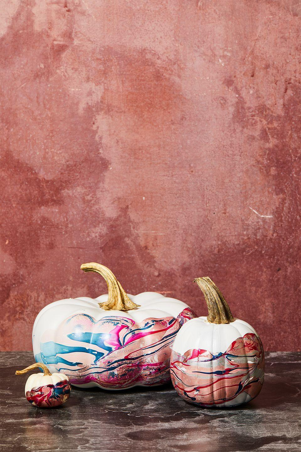 """<p>No paint? No problem. Grab a container filled with water and your favorite nail polish colors to create this on-trend design. </p><p><em><a href=""""https://www.goodhousekeeping.com/holidays/halloween-ideas/a34348351/how-to-marbled-pumpkins-with-nail-polish/"""" rel=""""nofollow noopener"""" target=""""_blank"""" data-ylk=""""slk:Get the tutorial »"""" class=""""link rapid-noclick-resp"""">Get the tutorial »</a></em></p>"""