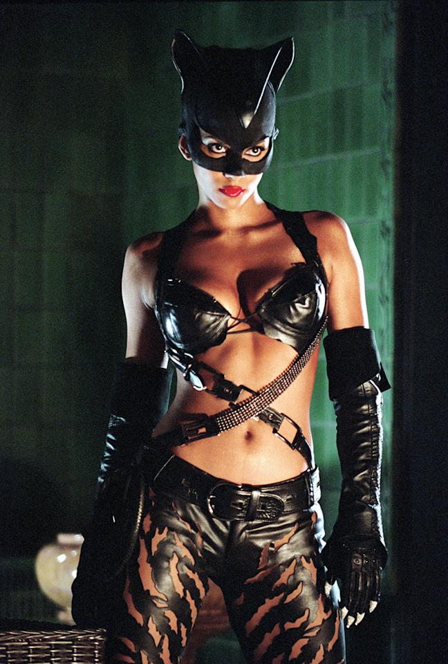 """<a href=""""http://movies.yahoo.com/movie/1808411823/info"""">CATWOMAN</a>   Never mind the ridiculous story, dialogue and acting, or that this Catwoman bears zero resemblance to any previous versions of the character. This movie's biggest sin is Halle Berry's dreadful costume, making her look like a feline-themed reject from an S&M lingerie show. Hang on tight to that Oscar, Halle."""