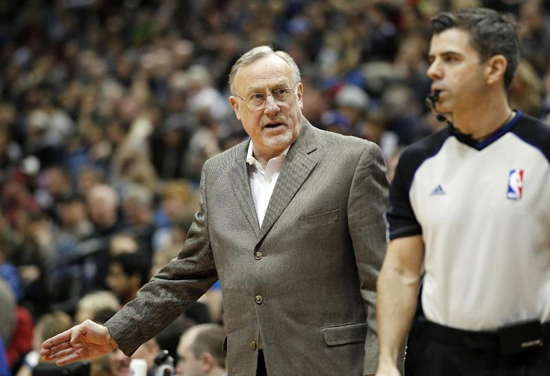 Minnesota Timberwolves head coach Rick Adelman, left, talks to referee Eli Roe in the fourth quarter of an NBA basketball game won by the Trail Blazers 117-110 on Saturday, Feb. 8, 2014, in Minneapolis