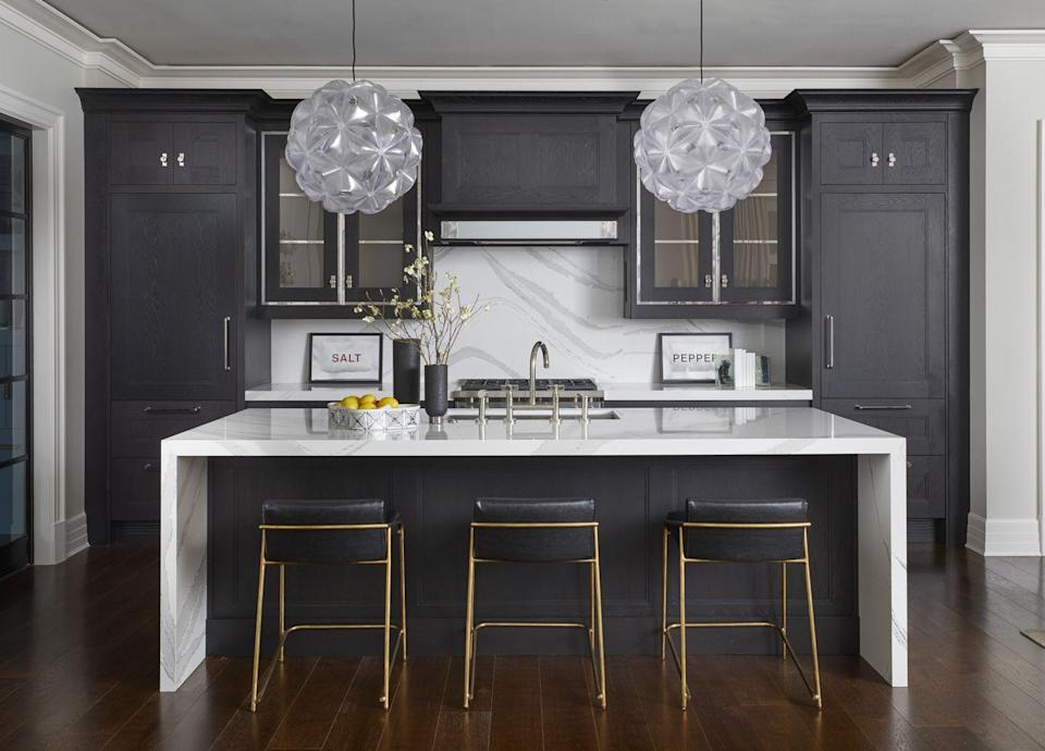 """<p>Cerused wood, which involves applying colored pigments while still allowing the wood's natural grain to shine through, is having a moment in both cabinetry and furniture, says <a href=""""https://www.donnamondi.com"""" rel=""""nofollow noopener"""" target=""""_blank"""" data-ylk=""""slk:Donna Mondi"""" class=""""link rapid-noclick-resp"""">Donna Mondi</a>. She suggests keeping the look more tonal—like these black cerused cabinets—than contrasting. """"It'll have more longevity down the road,"""" she says.</p>"""