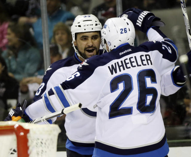 Winnipeg Jets' Dustin Byfuglien, left, celebrates his goal with teammate Blake Wheeler (26) during the second period of an NHL hockey game against the San Jose Sharks on Thursday, March 27, 2014, in San Jose, Calif. (AP Photo/Marcio Jose Sanchez)
