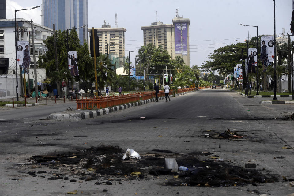 An empty street following curfew imposed by the government in Lagos, Nigeria, Thursday Oct. 22, 2020. Lagos streets were empty and shops were shuttered Thursday, as residents of Nigeria's largest city obeyed the government's curfew, stopping the protests against police brutality that had lasted for two weeks. ( AP Photo/Sunday Alamba)