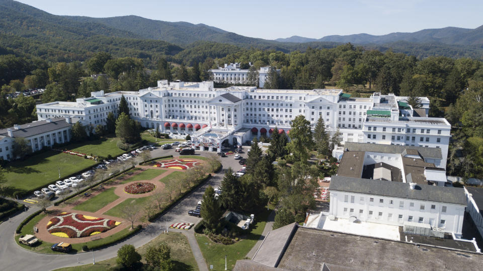 FILE - This is a Sept. 15, 2019, file photo showing The Greenbrier resort nestled in the mountains in White Sulphur Springs, W.Va. The West Virginia stop on the PGA Tour has fallen victim to the coronavirus pandemic and a schedule change to the fall. The PGA Tour and The Greenbrier resort announced Thursday, April 16, 2020, that A Military Tribute at The Greenbrier, scheduled for Sept. 10-13, has been canceled to make room for other tournaments that had been called off due to the virus. Both parties also announced that the remaining years of the tournament's contract through 2026 have been canceled. (AP Photo/Steve Helber, File)