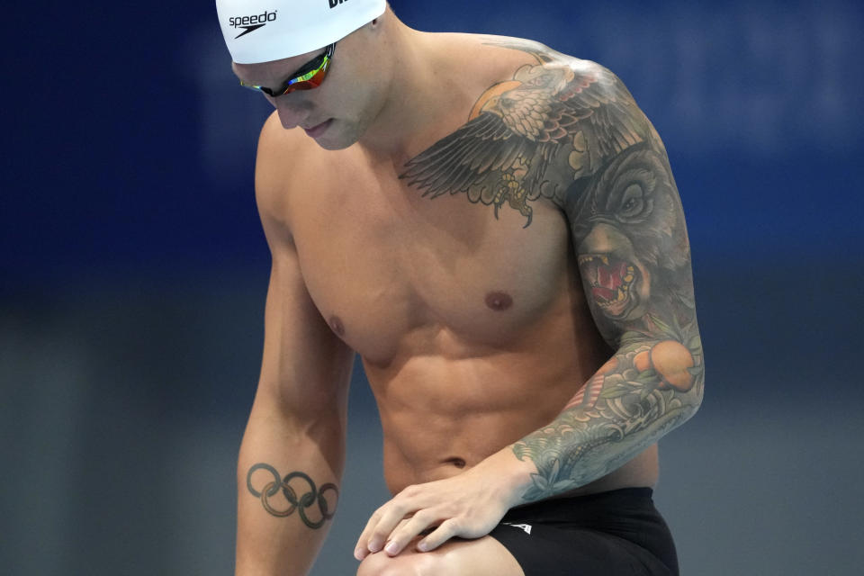 Caeleb Dressel of the United States stands on the start blocks for his heat of the men's 100-meter freestyle at the 2020 Summer Olympics, Tuesday, July 27, 2021, in Tokyo, Japan. (AP Photo/Matthias Schrader)