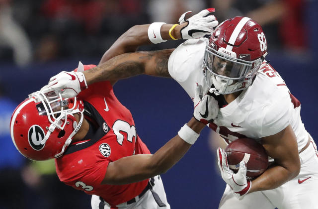 Alabama tight end Irv Smith Jr. (82) hits Georgia defensive back Tyson Campbell (3) in the helmet during the first half of the Southeastern Conference championship NCAA college football game, Saturday, Dec. 1, 2018, in Atlanta. (AP Photo/John Bazemore)
