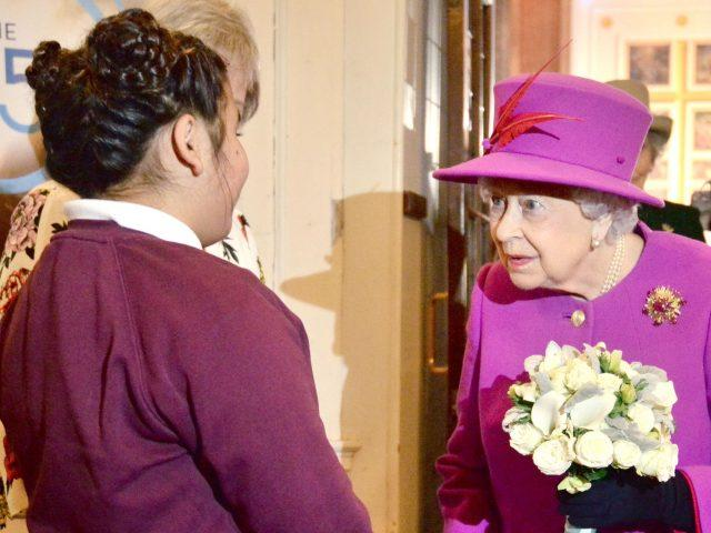 Olivia Yousaf presents the Queen with a posy (Victoria Jones/PA)