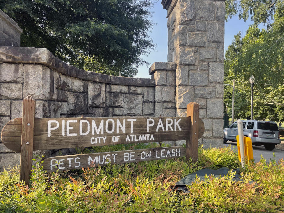 Authorities are searching for the person who fatally stabbed a woman who was walking her dog in Piedmont Park, one of Atlanta's most popular parks, Wednesday, July 28, 2021 in Atlanta. Katherine Janness, 40, was found dead in Piedmont Park around 1 a.m. Wednesday, police said. Her dog had also been killed. (AP Photo/R.J. Rico)