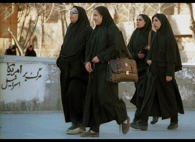 The Chador is more common to Iran. It is a long billowing dress that leaves the face open but covers the wrists and ankles. Chador's in a more plain black color with less decorative embellishments.