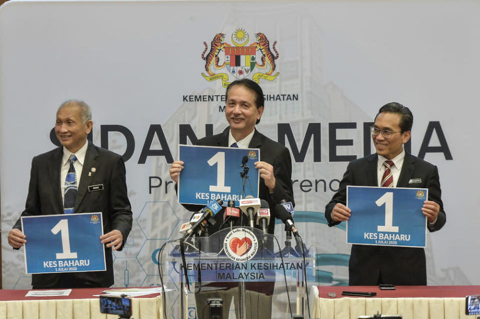 Health director-general Datuk Dr Noor Hisham Abdullah holding a poster showing the number of cases reported July 1, 2020 — Picture by Shafwan Zaidon