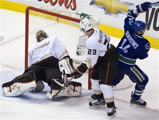 Vancouver Canucks right wing Alex Burrows (14) celebrates his goal past Anaheim Ducks goalie Jonas Hiller (1) as Ducks defenseman Francois Beauchemin (23) looks at the goal during the second period of an NHL hockey game in Vancouver, British Columbia, Tuesday, April, 3, 2012. (AP Photo/The Canadian Press, Jonathan Hayward)
