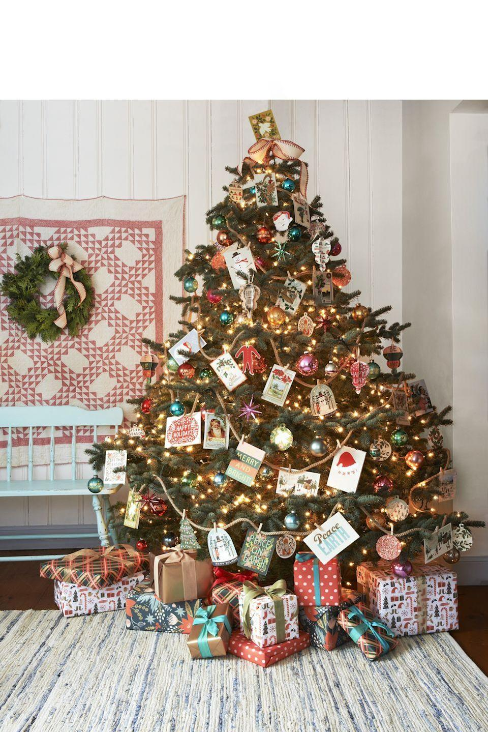 """<p>Get the softness of ribbon with a little less fuss by using jute rope for your garland. Add even more personality by hanging holiday greeting cards to the rope using mini clothespins.</p><p><a class=""""link rapid-noclick-resp"""" href=""""https://www.amazon.com/Tenn-Well-Gardening-Bundling-Decorating/dp/B077Z3XBWR/ref=sr_1_10?tag=syn-yahoo-20&ascsubtag=%5Bartid%7C10050.g.28703522%5Bsrc%7Cyahoo-us"""" rel=""""nofollow noopener"""" target=""""_blank"""" data-ylk=""""slk:SHOP JUTE ROPE"""">SHOP JUTE ROPE</a> </p>"""
