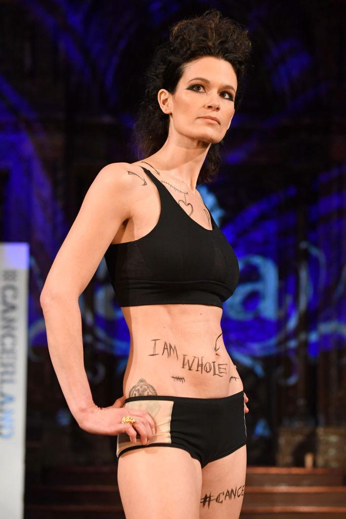 <p>A model wears a black bra and bottom set at the AnaOno x #Cancerland show during NYFW. (Photo: Getty) </p>