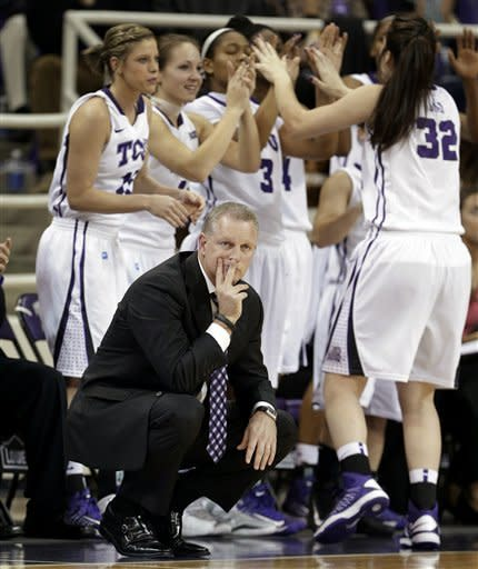 TCU head coach Jeff Mittie watches play as his team stands by the bench in the first half of an NCAA college basketball game against Baylor, Wednesday, Jan. 2, 2013, in Fort Worth, Texas. (AP Photo/Tony Gutierrez)