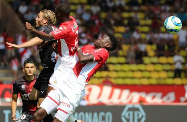 The referee threatened to stop the game in Monaco after fans insulted the league (AFP Photo/VALERY HACHE)
