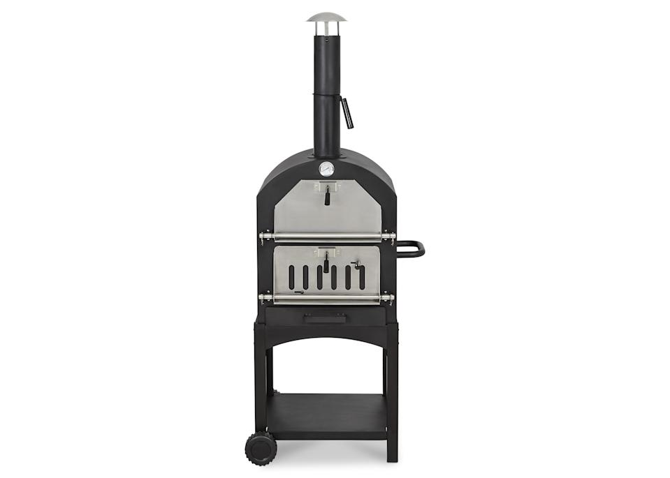 """If your dad is one of the first people on the street to fire up the barbecue at the first sign of summer then we recommend checking out the surprisingly affordable B&Q pizza oven. It's a win-win situation for the whole family. <a href=""""https://go.skimresources.com?id=134214X1597530&xs=1&url=https%3A%2F%2Fwww.diy.com%2Fdepartments%2Fblooma-maipo-charcoal-pizza-oven%2F1829862_BQ.prd%3Fds_kids%3D92700039952222737%26gclid%3DCj0KCQjwxYLoBRCxARIsAEf16-vP-l3y6iUr7Nl04FRIpN2PN78jTyro1g5aEAe9VMlbvr16qjFh5ogaAuD-EALw_wcB%26gclsrc%3Daw.ds"""" rel=""""nofollow noopener"""" target=""""_blank"""" data-ylk=""""slk:Buy now"""" class=""""link rapid-noclick-resp""""><em>Buy now</em></a><em>.</em>"""