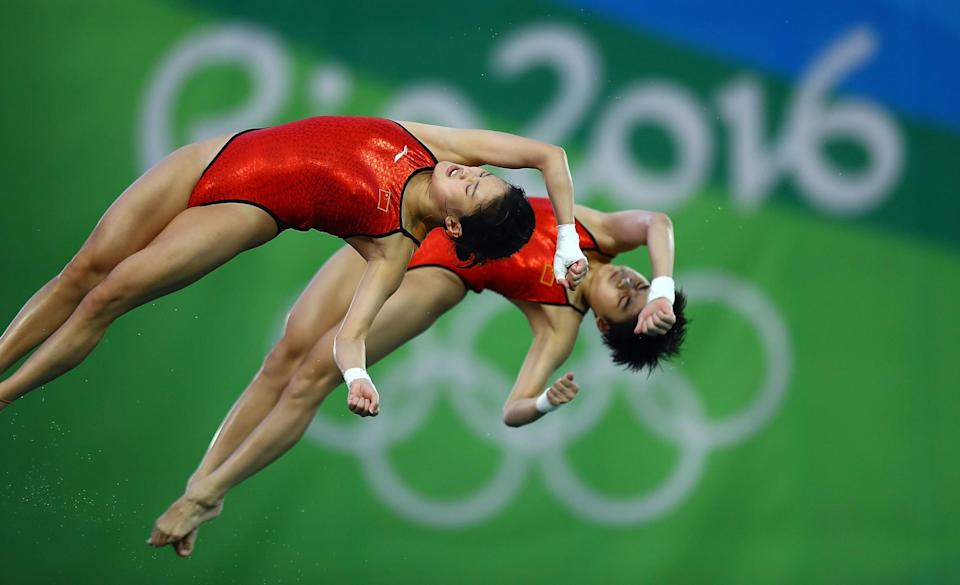 <p>Chen Ruolin and Huixia Liu of China compete in the Women's Diving Synchronised 10m Platform Final on Day 4 of the Rio 2016 Olympic Games at Maria Lenk Aquatics Centre on August 9, 2016 in Rio de Janeiro, Brazil. (Photo by Amin Mohammad Jamali/Getty Images) </p>