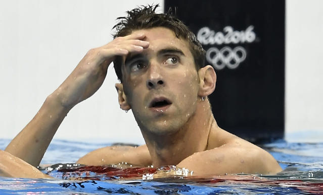 FILE - In this Aug. 10, 2016, file photo, United States' Michael Phelps checks his time after competing in a men's 200-meter individual medley semifinal during the swimming competitions at the 2016 Summer Olympics, in Rio de Janeiro, Brazil. After revealing the depths of his depression _ and even thoughts of suicide after his second drunken-driving arrest _ Phelps is hoping to make a difference for those who are dealing with similar issues. The 23-time Olympic gold medalist announced a partnership with Talkspace, which provides online therapy, and said he considers it a higher calling than anything he ever did as a swimmer.(AP Photo/Martin Meissner, File)
