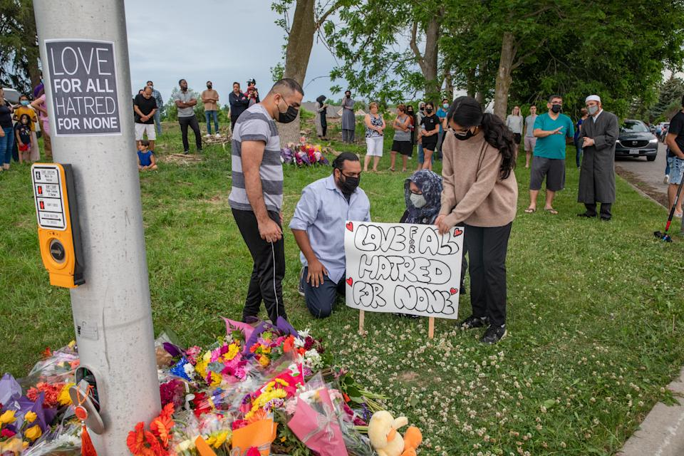 ONTARIO, CANADA - JUNE 07: People attend a memorial at the location where a family of five was hit by a driver, in London, Ontario, Canada, June 7, 2021. Four of the members of the family died and one is in critical condition. A 20 year old male has been charged with four counts of first degree murder and count of attempted murder in connection with the crime. (Photo by Brett Gundlock/Anadolu Agency via Getty Images)
