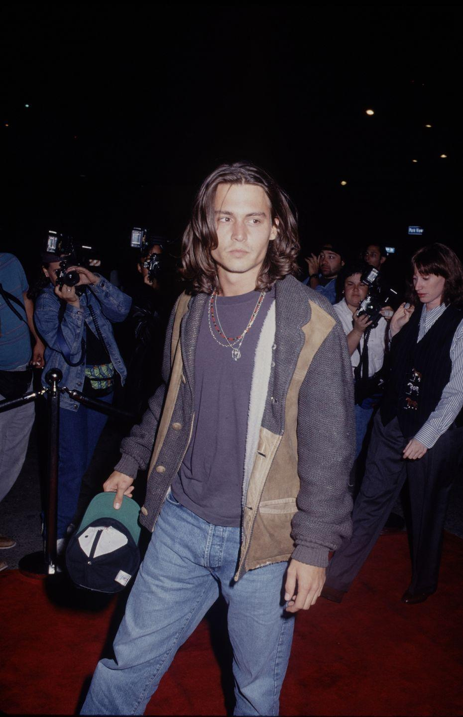 <p>Long before his <em>Pirates of the Caribbean </em>days, Johnny Depp opted for a longer cut. The actor (who had just begun to date Winona Ryder around this time) was known for his shaggy look, but grew it out to new lengths in the 1990. </p>