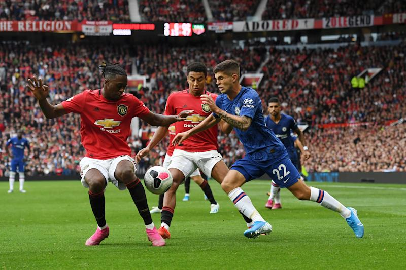 MANCHESTER, ENGLAND - AUGUST 11: Christian Pulisic of Chelsea battles for possession with Manchester United players Aaron Wan-Bissaka and Jesse Lingard during the Premier League match between Manchester United and Chelsea FC at Old Trafford on August 11, 2019 in Manchester, United Kingdom. (Photo by Clive Howes - Chelsea FC/Chelsea FC via Getty Images)