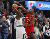 Denver Nuggets forward Will Barton, left, looks to pass the ball as Toronto Raptors guard Kyle Lowry defends in the first half of an NBA basketball game Sunday, March 1, 2020. (AP Photo/David Zalubowski)