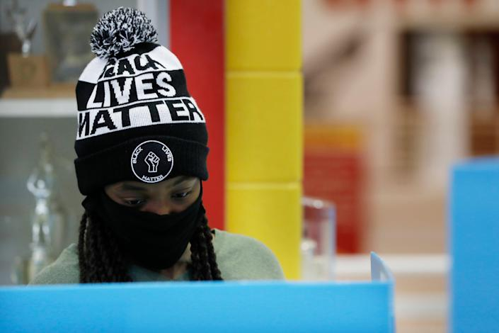 First-time voter Alexis Gresham, 23, casts her ballot Nov. 3, 2020, at Clarke Central High School in Athens, Ga.