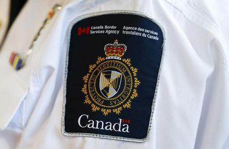 A Canada Border Services Agency (CBSA) logo is seen on a worker during a tour of the Infield Terminal at Toronto Pearson International Airport