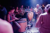 The drummers followed the leader thanks to a local music language called Rhythm with Signs invented by Santiago Vazquez, founder of the Bomba de Tiempo.