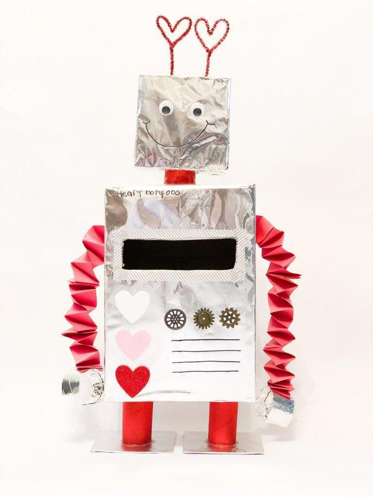 """<p>Who wouldn't fall in love with this smiling robot? Make it out of recycled boxes and household supplies.</p><p><strong>Get the tutorial at</strong> <a href=""""https://momofwarhearmyroar.com/how-to-make-a-robot-valentine-box/"""" rel=""""nofollow noopener"""" target=""""_blank"""" data-ylk=""""slk:Mom of W.A.R. Hear My Roar."""" class=""""link rapid-noclick-resp""""><strong>Mom of W.A.R. Hear My Roar. </strong></a></p><p><a class=""""link rapid-noclick-resp"""" href=""""https://www.amazon.com/Reynolds-Wrap-Heavy-Aluminum-Square/dp/B00LOQD5LA/?tag=syn-yahoo-20&ascsubtag=%5Bartid%7C2164.g.35119968%5Bsrc%7Cyahoo-us"""" rel=""""nofollow noopener"""" target=""""_blank"""" data-ylk=""""slk:SHOP FOIL"""">SHOP FOIL </a></p>"""