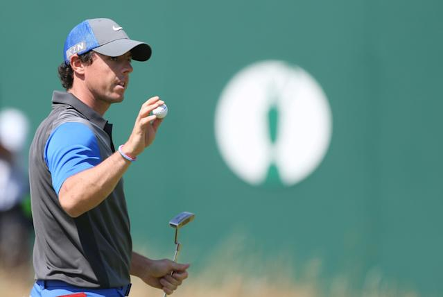 Rory McIlroy of Northern Ireland holds up his ball on the 18th green after his round on the first day of the British Open Golf championship at the Royal Liverpool golf club, Hoylake, England, Thursday July 17, 2014. (AP Photo/Peter Morrison)