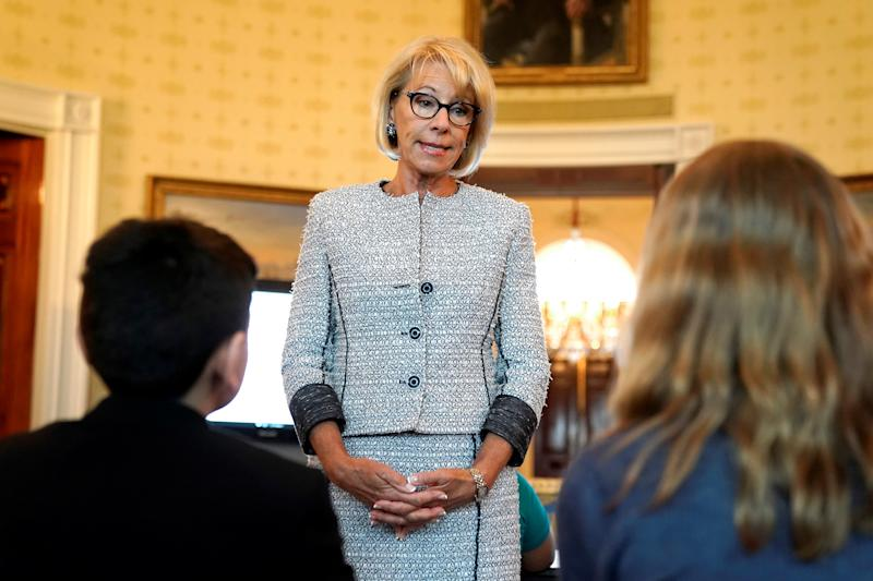 U.S. Secretary of Education Betsy DeVos speaks with school children during a listening session before the arrival of U.S. first lady Melania Trump at the White House in Washington, U.S., April 9, 2018. REUTERS/Joshua Roberts