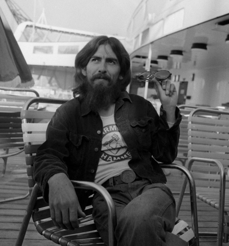 <p>George Harrison aboard the ocean liner QE2 from New York after three months recording in America in 1971.</p>
