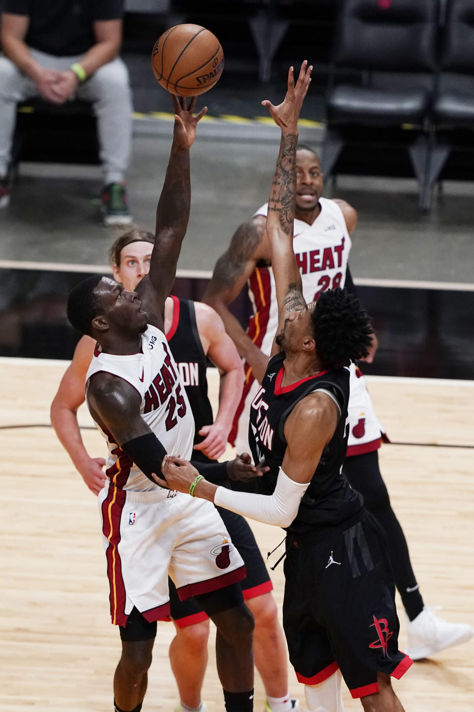 Miami Heat guard Kendrick Nunn (25) drives to the basket as Houston Rockets center Christian Wood defends, during the second half of an NBA basketball game, Monday, April 19, 2021, in Miami. (AP Photo/Marta Lavandier)