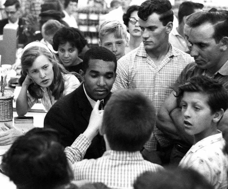 Howard University student Dion Diamond surrounded by white youths at a lunch counter sit-in on June 9, 1960, in Arlington, Virginia.