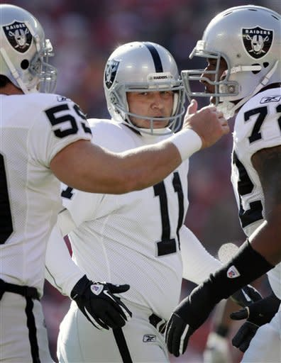 Oakland Raiders kicker Sebastian Janikowski (11) celebrates a field goal with long snapper Jon Condo (59) and tackle Joe Barksdale (72) during the first half of an NFL football game against the Kansas City Chiefs in Kansas City, Mo., Saturday, Dec. 24, 2011. (AP Photo/Ed Zurga)
