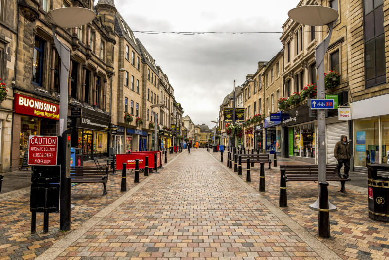 A popular for shopping and dining walking High Street in Inverness historical city centre, Scotland, October 2017