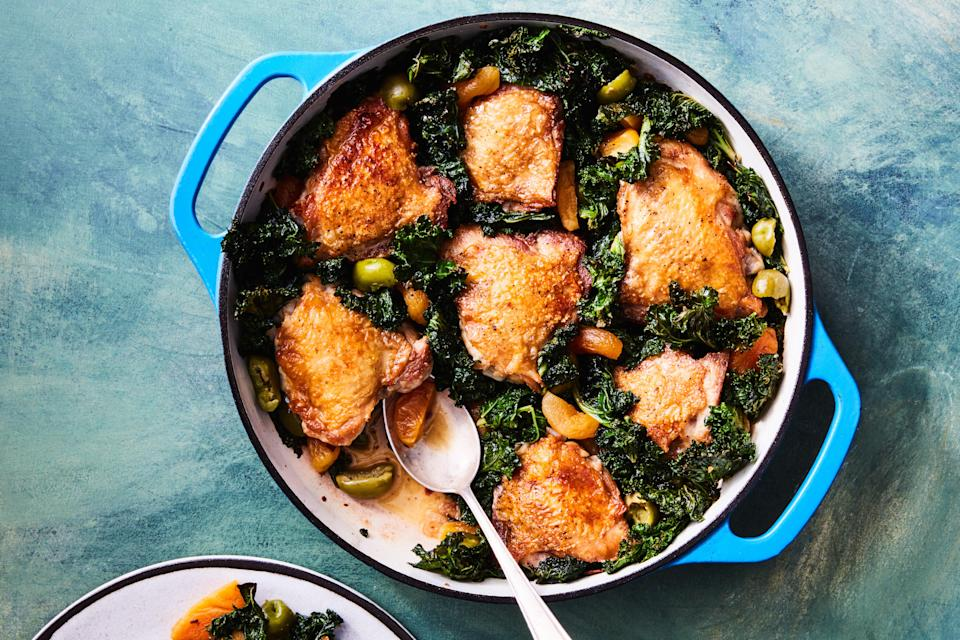 """While the chicken braises in the oven, the kale gets nice and crispy, making it the most irresistible part of this cozy but elegant one-pot dish. <a href=""""https://www.epicurious.com/recipes/food/views/crispy-chicken-thighs-with-kale-apricots-and-olives?mbid=synd_yahoo_rss"""" rel=""""nofollow noopener"""" target=""""_blank"""" data-ylk=""""slk:See recipe."""" class=""""link rapid-noclick-resp"""">See recipe.</a>"""