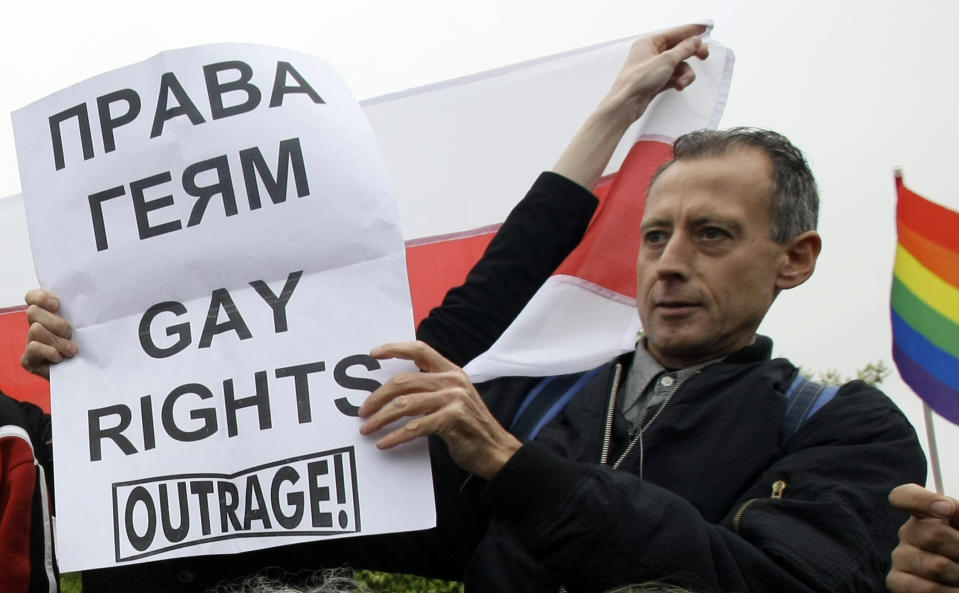 """British gay rights activist Peter Tatchell holds a a poster reading """"Gay Rights"""" during a gay rights protest in Moscow, Russia, Saturday, May 16, 2009. Moscow police have violently dispersed a gay pride parade banned by the authorities. Riot police broke up a protest by around 20 gay pride activists, dragging them into detention buses. Activists called Russia's alleged homophobia """"a disgrace."""" (AP Photo/Misha Japaridze)"""