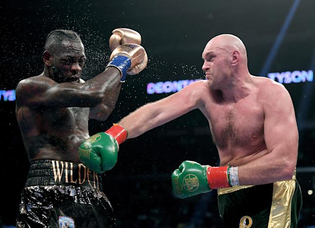 Tyson Fury, landing a right on Deontay Wilder during their heavyweight title fight on Dec. 1 in Los Angeles, informed the WBC that he plans to take another bout before doing a rematch with Wilder. (Getty Images)