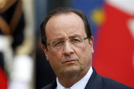 French President Francois Hollande stands on the steps of the Elysee Palace in Paris