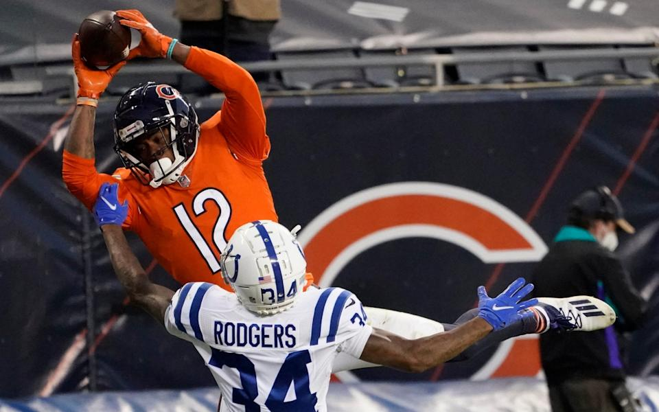 Chicago Bears' Allen Robinson (12) makes a touchdown reception against Indianapolis Colts' Isaiah Rodgers (34) during the second half of an NFL football game, Sunday, Oct. 4, 2020, in Chicago. - AP