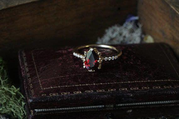 """<i>Buy it from <a href=""""https://www.etsy.com/listing/491794784/garnet-engagement-ring-pear-engagement?ref=shop_home_active_20"""" target=""""_blank"""">TheNorthWayStudio on Etsy</a>for$1,200.</i>"""