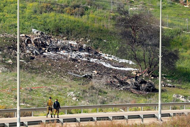 """<p>A picture taken in the northern Israeli Kibbutz of Harduf on Feb. 10, 2018, shows the remains of an Israel F-16 that crashed after coming under fire by Syrian air defences during attacks against """"Iranian targets"""" in the war-torn country. (Photo: Jack Guez/AFP/Getty Images) </p>"""