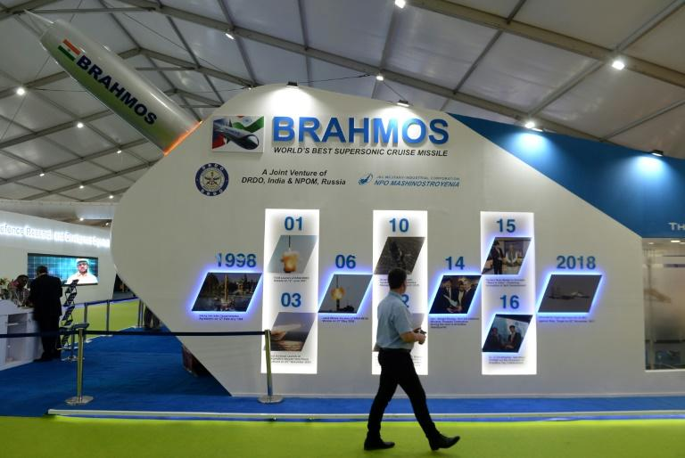 A man walks past a display for the Brahmos missile at DefExpo 2018 in Chennai. India wants to soon start selling the missile to other countries