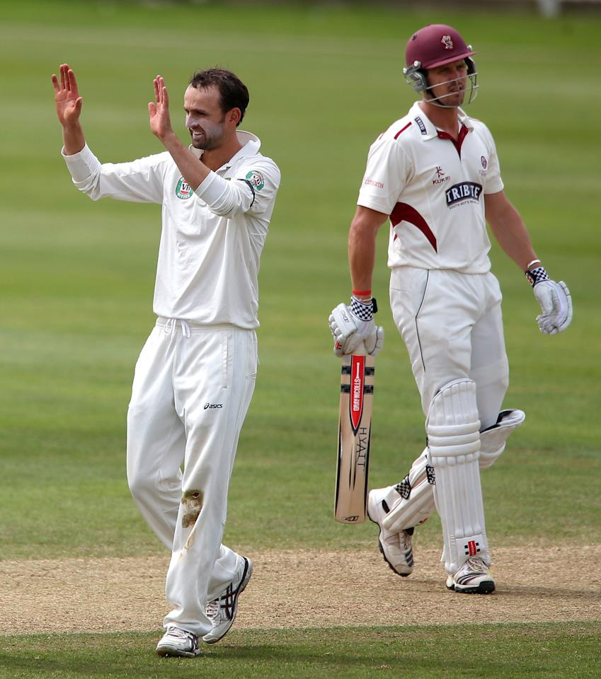 Somerset's Nick Compton shows his dejection after he was trapped LBW by Australian bowler Nathan Lyon (left), during the International Tour match at the County Ground, Taunton.