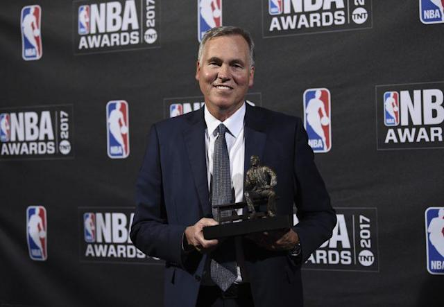 Mike D'Antoni shows off his 2017 Coach of the Year trophy. (AP)