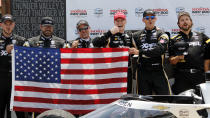 Josef Newgarden celebrates with his team in victory lane after winning an IndyCar race at Mid-Ohio Sports Car Course in Lexington, Ohio, Sunday, July 4, 2021. (AP Photo/Tom E. Puskar)