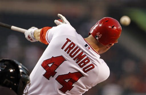 Los Angeles Angels' Mark Trumbo connects on a single against the Cleveland Indians in the second inning of a baseball game in Anaheim, Calif., Wednesday, Aug. 15, 2012. (AP Photo/Reed Saxon)