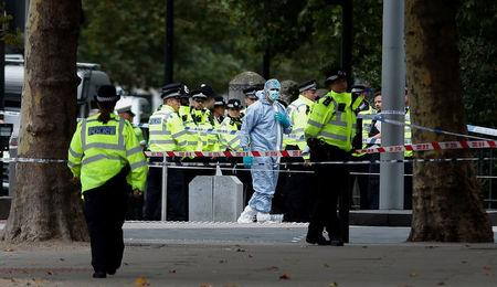 Police and forensic officers gather in the road near the Natural History Museum, after a car mounted the pavement, in London, Britain October 7, 2017. REUTERS/Peter Nicholls