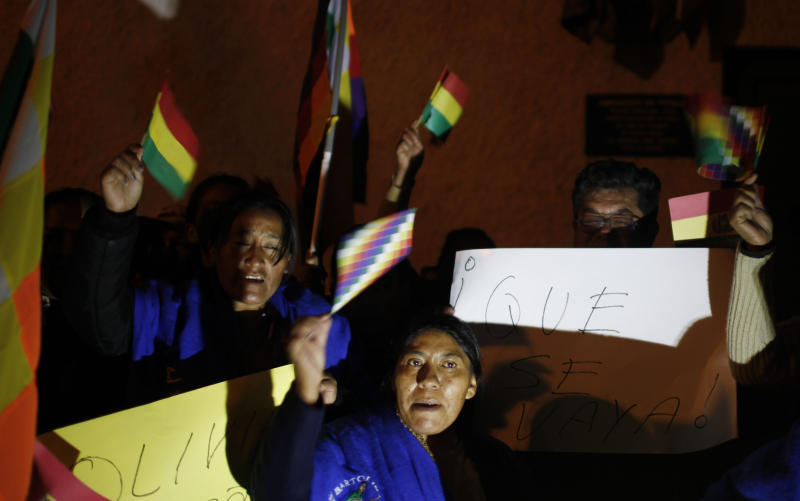 Supporters of Bolivia's President Evo Morales shout and wave Bolivian and indigenous flags outside France's embassy as they protest in La Paz, Bolivia, Tuesday, July 2, 2013. Bolivia's Foreign Minister David Choquehuanca says the plane bringing President Evo Morales home from Russia was rerouted to Austria after France and Portugal refused to let it to cross their airspace because of suspicions that NSA leaker Edward Snowden was on board. Officials in both Austria and Bolivia said that Snowden was not on the plane. (AP Photo/Juan Karita)